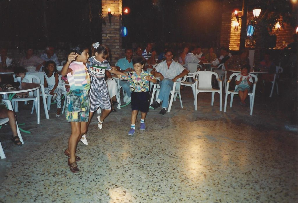 Summer 1991 Yannos, Fei and Andy 3 cousins dancing Sirtaki