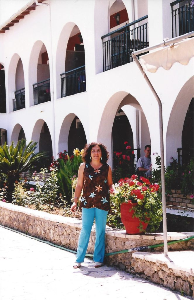 Summer 2002 Wafaa standing in front of the garden and hotel bui